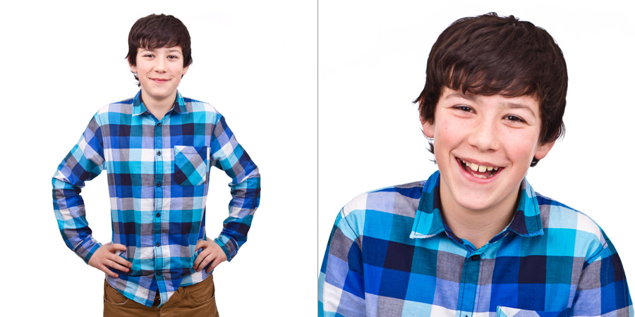 Smiling teen boy against white background
